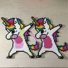 Made dabbing unicorn perler bead sprites because how could I not. Original photo was a t shirt design and it has a shadow I wasn't sure about. So I made one without the shadow as well. Which do you like better? Perler Bead Designs, Hama Beads Design, Diy Perler Beads, Perler Bead Art, Hama Beads Kawaii, Hama Beads Coasters, Pearler Bead Patterns, Perler Patterns, Disney Hama Beads Pattern