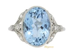 Solitaire aquamarine ring with diamond set shoulders, circa 1910. from Berganza London Hatton Garden