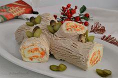 Iltronchetto di Natale salatoè un'ottima idea per l'antipasto di questa importante festività. E' facile da realizzare e potete farcirlo come preferite.