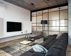 Concrete, an open floor plan, and lots of space define these three gorgeous spaces and they prove lofts don't always have to be cold and dreary. The first home