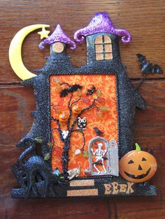 Super cute hand made Halloween decoration from a repurposed frame and costume jewelry! On Etsy!!! $49