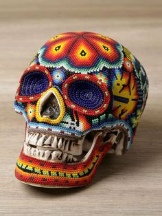 Actually I'm not sure where to pin this. It's cool, it's uber-creepy.  Beaded skulls from 'Our Exquisite Corpse'.  They work with the Huichol people in Mexico.  Read the story: http://www.hintmag.com/post/mood-board--october-12-2011-1318
