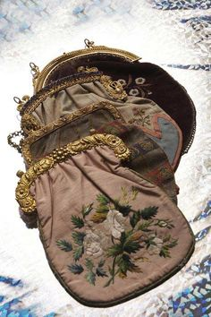 'At The Russian Court' - Image from the Hermitage, Amsterdam <> Front to back:  Embroidered Pink Moiré Silk Bag 1820s–30s, Metallic Gauze Bag Embroidered in Coloured Silks 1820s–30s, Russian Blue & Striped Silk Bag, 1800–1810, Velvet Bag Embroidered w Beads, 1820s–30s. Lovely & interesting! www.hermitage.nl/en/pers/russische_hof/beeldmateriaal.htm