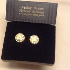 Evening Drama pierced earrings w/surgical St post This is a classy pair of evening drama pierced earrings with surgical steel posts. Sold by Avon. This is a vintage pair from 1994. Round. Shine nicely. Great condition never used vintage old stock. Amazing looking and condition. Avon Jewelry Earrings