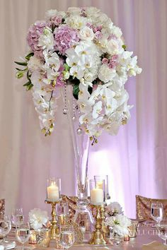 Tall florals to include candle clusters and uplighting