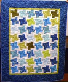 This tranquil quilt was quilted by our newest longarmer, Penny Ross.  Wunderbar!