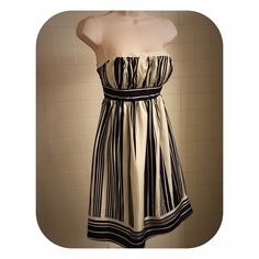 Cream & Black Striped Strapless Dress This stunning & elegant strapless cream silk dress w/black stripes has a ruched vertically striped bust, w/boning to keep its shape & is framed w/a cream colored satin band at the top & cinched below w/a black & cream horizontally striped band, creating contrast & a flattering silhouette. Below the band the vertically striped A-line skirt flows. The bottom of the dress is accented with black & cream vertical stripes. Fully lined w/a back zip. Worn once…
