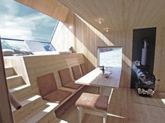 Tiny compact wooden home, with comfortable seating for 8.