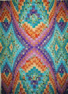 Beautiful patterns and colors in this quilt. Another bargello pattern.
