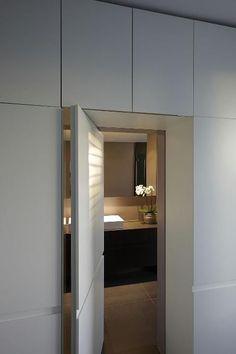 hidden desk in modern closet envelope doors Bathroom Doors, Bathroom Interior, Flur Design, Hidden Rooms, Hidden Desk, Hidden Closet, Hidden Kitchen, Modern Closet, Apartment Entryway