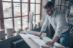 Buy Mature man at work in the studio by AboutImages on PhotoDune. Mature man with drawing at work Architect Career, Typography Design, Branding Design, Paper People, Working Man, Men Photography, Architecture Student, Male Man, Technical Drawing