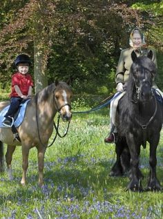 James, Viscount Severn, riding with his grandmother, Queen Elizabeth II. James's father is Prince Edward.