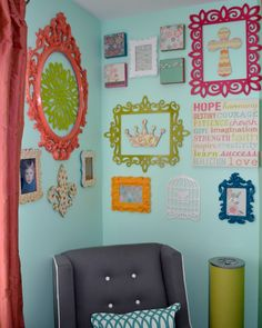 Funky, colorful #gallerywall - we like how it's positioned on two walls in the corner!