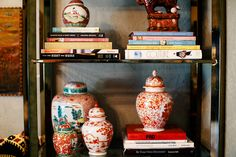 Bookshelves styled with thrift-store finds