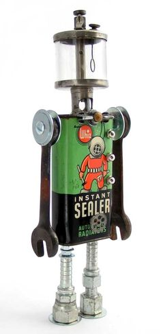"""""""Aqualung""""   Height: 14""""   Principal Components: Radiator sealant tin, engine oiler, wrenches, hose fittings, turn button, clock gear"""