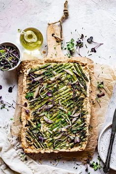 Asparagus Shallot Tart | Healthy Little Vittles | An easy savory tart made with a 6 ingredient gluten-free, grain-free, vegan crust topped with vegan ricotta cheese, fresh asparagus, shallots, chives, and microgreens. A beautiful savory tart perfect for a holiday brunch or side dish to impress.