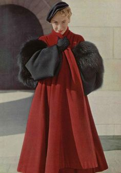 Staying warm, 1949. Christian Dior red and black wool coat with fox fur cuffs