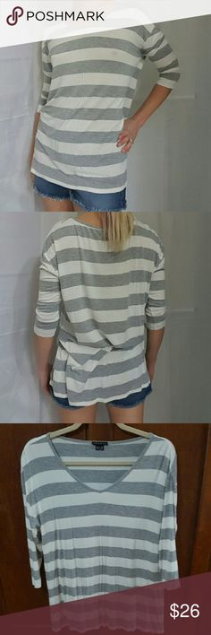 Theory Striped Top S Flowy and comfortable. Sized a little big. Super soft. 3/4 sleeve. Good overall condition. Some fading and pilling of fabric (see close-up pic)  For reference, I'm 5'5 and normally wear a size S/2/4 Theory Tops Blouses