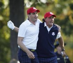 September 28, 2012 - Keegan Bradley and Phil Mickelson congratulate each other after Mickelson's drive on the 17th hole land just feet from the cup. That drive clinched the match for their round and gave the US team another point Friday afternoon at the 2012 Ryder Cup at Medinah Country Club.