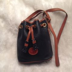 Authentic DOONEY&BOURKE AWL CrossBody Bag In good shape. There's some white paint marks that I will leave to the buyer to remove with the right solvent. Clean liner. There's a really small spot (dime size) with a little bit of leather wear. Measures 7x8 Dooney & Bourke Bags Crossbody Bags