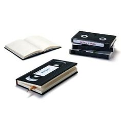 a hardcover journal in a retro design, with retro vhs label stickers and a protective sleeve