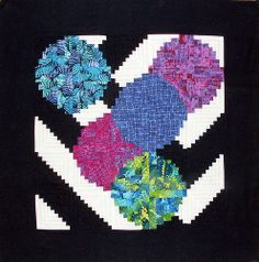 Linda Rotz Miller's Bubbles & Logs quilt. Fresh, innovative quilt combining traditional and curved Log Cabin blocks.
