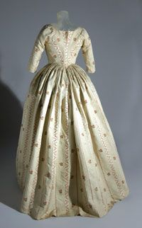 "Dress (Robe à l'anglaise), United States, Silk: c. 1772-73; Dress: c. 1783, Silk satin and tobine (cannelé) stripes brocaded with colored silks. ""This dress is ascribed to the trousseau of Rachel Bolitho, daughter of Captain John Bolitho, a shipmaster who had come to America from Cornwall, England, in about 1741. This silk was likely woven by the London Spitalfields firm Batchelor, Ham and Perigal in about 1772-73."" Philadelphia Museum of Art"