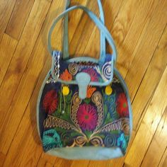 Floral Hand Bag Intricate floral purse with plenty of room inside, it contains one pocket inside otherwise its an open zip purse. Such beautiful colors perfect for summer! Bags Shoulder Bags