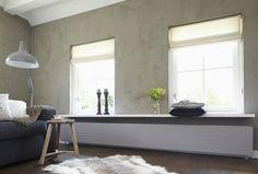 Wit plafond en kalkverf muur