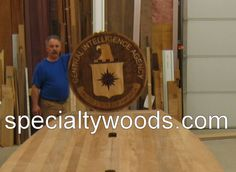 Neal Burns in the  Specialty Woods wood shop finishing up the inlaid CIA Seal, Need a custom inlaid logo, call 509-466-4684