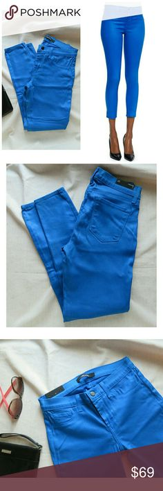 "NWT J Brand Blue Lacquered 835 Capri Pant 27 Can't get over this color! Gorgeous cerulean /indigo ""breakwater"" blue with a glowing ""lacquered"" sheen that looks almost like leather! Hard to find/sold out at Neiman Marcus, very rare! J Brand 835 mid-rise capri jeans/ ankle pants denim. Authentic, bought new with tags (through website so no hang tags). Measuring lying flat 14"" across waist, 8.5"" rise, about 16.5"" across hips, and 27"" inseam. All stretch, Lyocell blend. Packed carefully and…"