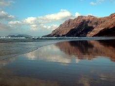 Famara is a huge crescent beach that offer reflections when the tide is out