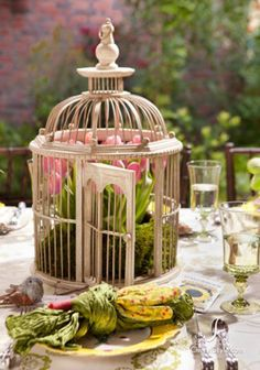 birdcage with flowers centerpiece for garden table