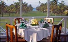 Dine al fresco gazing down the Avenue of Palms in the Great House at Nisbet Plantation Beach Club, #Nevis, #Caribbean. nisbetplantation.com