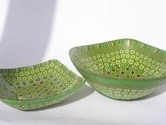 bowls covered in polymer clay by Orly Rabinowitz
