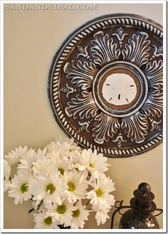 Using a ceiling medallion and chocolate brown paint, you can make a piece of wall art.  A mirror would be great in the center as well.