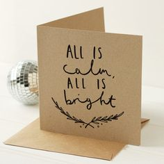 A bold and stylish Christmas card illustrated with the festive lettering All is calm, all is bright, printed on to recycled kraft card. by oldenglishco