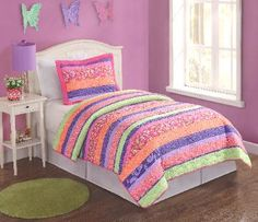 Stripes and Flowers Bedding  Pop that room with this collection of floral prints   in an array of bright colors. This easy care   microfiber pattern is the perfect addition to your   fun and bright bedroom.    Features fun pinks, purples, orange, and lime   green.      This bedding set is being offered for   a limited time only!