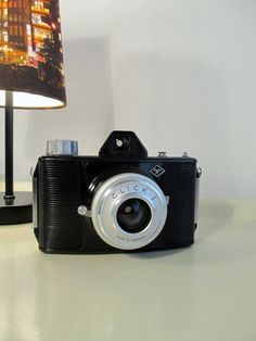 Vintage Camera Agfa Click I with case in leather and a new 120 standard roll film in color