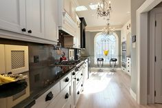 Glamorous Victorian in Yorkville: The kitchen also contains a built-in desk with a granite work surface and a wall-mounted television (so you can follow along with cooking shows)