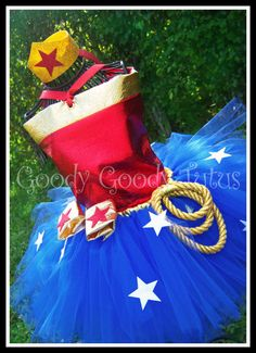 LITTLE MISS WONDERFUL Wonder Woman Inspired Corset Top and Tutu Set with Wrist Cuffs and Tiara. $95.00, via Etsy.