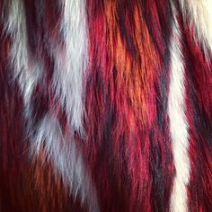 Detail of fire-inspired fur, backstage at #RobertoCavalli #MFW (à Piazza Sempione)