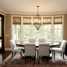 In the dining room. The bamboo finish on these woven wood window treatments gives this dining room a. Dining Room Windows, Dining Room Colors, Dining Room Design, Dining Rooms, Dining Area, Dining Table, Kitchen Windows, Bay Windows, Sunroom Windows