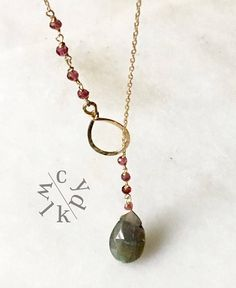 This gorgeous gold filled lariat features a beautiful pear shaped labradorite gemstone. Labradorite is a mystical stone and reflects different colors - a sparkle of blue here and green there! I love working with this stone. I have added pink tourmaline beads to this necklace. The metaphysical