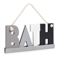 Add a touch of personality to your bathroom with this stylish wooden 'bath' plaque. It comes in a striking grey, black and white colorway with a rope handle for hanging.