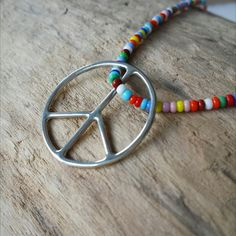 our multi-colored necklace with a handmade peace sign is the perfect everyday symbol of peace and of the fact that we are all connected. Gifts For Girls, Gifts For Her, Minimalist Necklace, Summer Jewelry, Boho Necklace, Gold Jewelry, Beaded Bracelets, Symbols, Peace