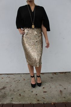 The Kalina Skirt is the pinnacle of glam in shiny gold sequin mesh. An effortless way to elevate your party look, this pencil skirt sparkles and is sure to grab all the attention. -Available in Gold s