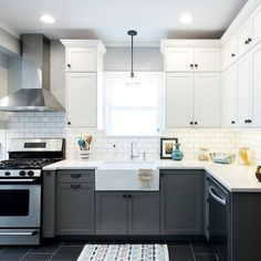 "Two tone #kitchen cabinets are one of the trends we love this year. This vintage modern kitchen embraces the trend thanks to dark grey base cabinets topped with crisp, clean upper shaker-style cabinets in /benjaminmoore/ Dove."" Off-white quartz countertops and a ceramic subway backsplash with dark grey grout complete the look. Check out all the hotteset trends for 2016 via /houzz/ http://www.houzz.com/ideabooks/58454857/list/25-design-trends-coming-to-homes-near- Need help getting your own…"