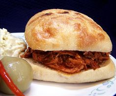 "Pulled Chicken Sandwiches from the Slow Cooker: ""The sauce is tangy and flavorful but too spicy. The amount of hot sauce is just enough to balance the sweetness of the ketchup. Certainly mild enough to serve to kids."" -justcallmetoni"