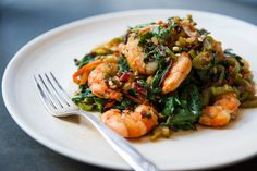 This is delicious!  Spicy sautéed chard with chiles and ginger is full of flavor, easy and pleasing with pretty much any protein Here, it moves to the center of the plate with plump, seared shrimp Any kind of chard can be used for this dish, but rainbow or red will be prettier than white-stemmed Swiss chard